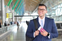Handsome businessman smiling at the airport with space for copy Royalty Free Stock Image