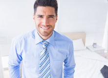 Handsome businessman smiling at camera Stock Photo