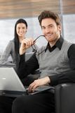 Handsome businessman smiling happily Stock Photography