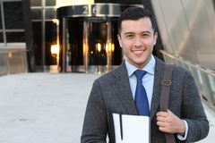 Handsome businessman smiling outside the office building.  stock photo