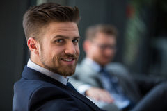 Handsome businessman smiling Royalty Free Stock Photos