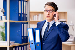 The handsome businessman speaking on mobile phone Royalty Free Stock Photos