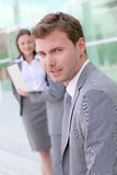Handsome businessman standing in front of modern buidling Royalty Free Stock Images