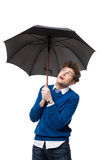 Handsome businessman standing under umbrella Royalty Free Stock Photography