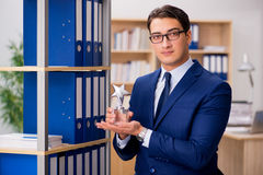 The handsome businessman with star award Stock Photos