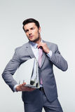 Handsome businessman straightening his tie Royalty Free Stock Photos