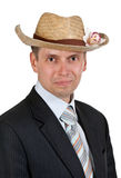 Handsome businessman with a straw hat Royalty Free Stock Images
