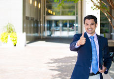 handsome businessman in suit giving thumbs up Royalty Free Stock Photo