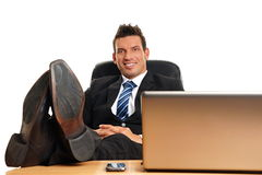Handsome businessman in suit relaxes Stock Photos