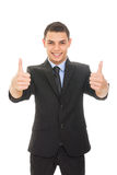Handsome businessman in suit showing thumbs up Royalty Free Stock Images