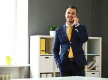 Handsome businessman in suit speaking on the phone Stock Photography