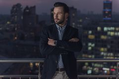 Handsome businessman in the evening Royalty Free Stock Image