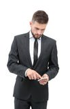 Handsome businessman in suit using the phone in office Stock Images