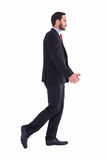 Handsome businessman in suit walking away Stock Photos
