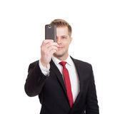 Handsome businessman taking a selfie Stock Photos