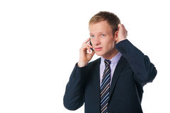 Handsome businessman talking on cell phone Stock Image