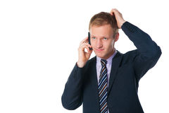 Handsome businessman talking on cell phone Stock Images