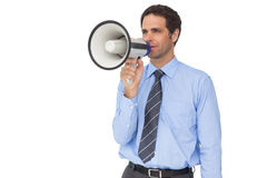 Handsome businessman talking through megaphone Royalty Free Stock Photography
