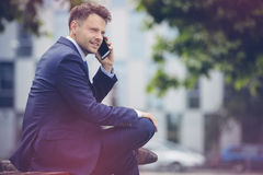 Handsome businessman talking on mobile phone Royalty Free Stock Image