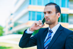 Handsome businessman talking over cellphone Royalty Free Stock Image