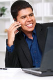 Handsome businessman talking on phone Royalty Free Stock Images
