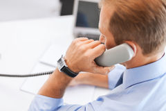 Handsome businessman talking on the phone Stock Images