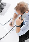 Handsome businessman talking on the phone Royalty Free Stock Photos
