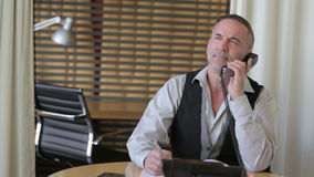 handsome businessman talking on the phone stock footage