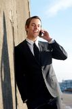 Handsome businessman talking on phone outdoors. Close up portrait of a handsome businessman talking on phone outdoors Stock Image