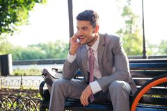Handsome businessman talking on the phone outdoors Royalty Free Stock Photography