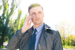Handsome businessman talking on the phone outdoors Royalty Free Stock Image