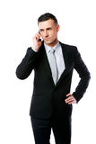 Handsome businessman talking on the phone. Over white background Stock Photos