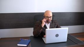 Handsome businessman talking at phone. Phone Talk, Young Man at Work. Handsome businessman talking at phone. Phone Talk, Young Man or manager at Work. 4 k stock footage