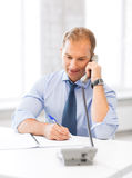 Handsome businessman talking on the phone Royalty Free Stock Image