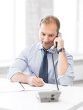 Handsome businessman talking on the phone Royalty Free Stock Images
