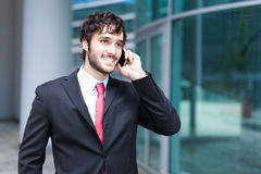 Handsome businessman talking on the phone Stock Photography