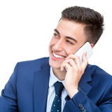Handsome businessman talking on smart phone. Royalty Free Stock Images