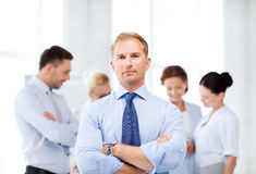 Handsome businessman with team in office Royalty Free Stock Photos