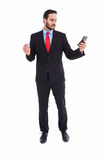 Handsome businessman texting on phone Royalty Free Stock Photos