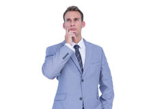 Handsome businessman thinking with finger on chin Royalty Free Stock Images