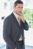 Handsome businessman thinking Royalty Free Stock Photos