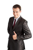 A handsome businessman with thumbs up Stock Images