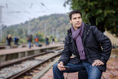 Handsome businessman at train station Royalty Free Stock Image