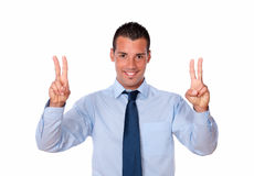 Handsome businessman with two victory sign Royalty Free Stock Photos