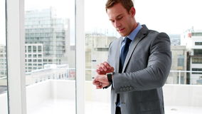 Handsome businessman using his smart watch stock video footage