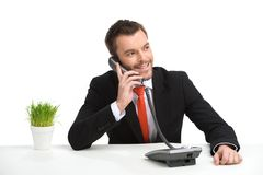 Handsome businessman using landline phone. Stock Image