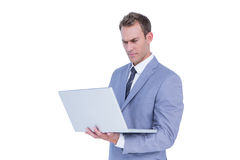 Handsome businessman using laptop computer Royalty Free Stock Photos