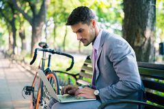 Handsome businessman using laptop Stock Images