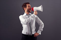 Handsome businessman using megaphone Stock Images