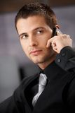 Handsome businessman using mobile Royalty Free Stock Photography
